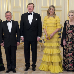 Jordan's King Abdullah II, second left, and Queen Rania, left, Dutch King Willem-Alexander, center, Queen Maxima, second right, and Princess Beatrix, right, pose for the official family photo at royal palace Noordeinde in The Hague, Netherlands, Tuesday, March 20, 2018.