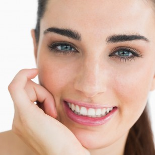 Woman with clear eyes looking at camera and smiling