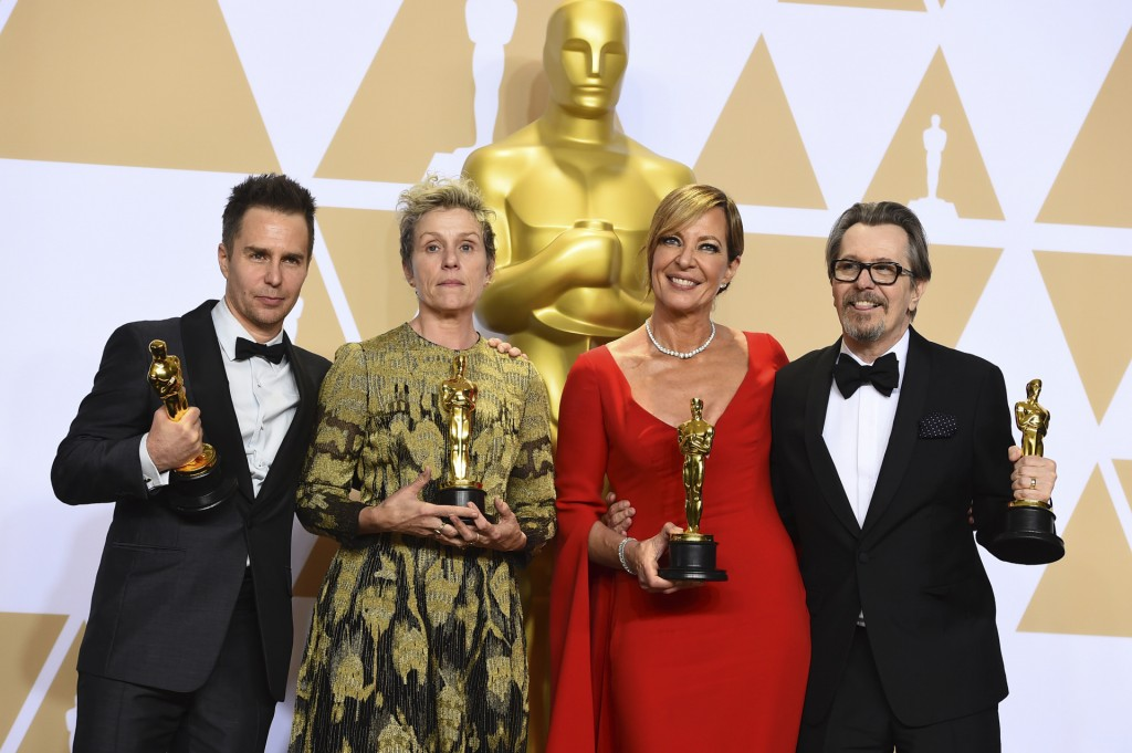 """Sam Rockwell, from left,Hinner H the award for best performance by an actor in a supporting role for """"Three Billboards Outside Ebbing, Missouri"""", Frances McDormand, winner of the award for best performance by an actress in a leading role for """"Three Billboards Outside Ebbing, Missouri"""", Allison Janney, winner of the award for best performance by an actress in a supporting role for """"I, Tonya"""", and Gary Oldman, winner of the award for best performance by an actor in a leading role for """"Darkest Hour"""", pose in the press room at the Oscars on Sunday, March 4, 2018, at the Dolby Theatre in Los Angeles. (Photo by Jordan Strauss/Invision/AP)"""