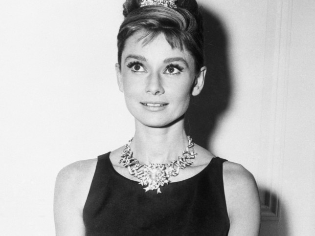 Audrey Hepburn, about to begin filming for Breakfast At Tiffany's, wears one of the store's most expensive diamond necklaces. New York.