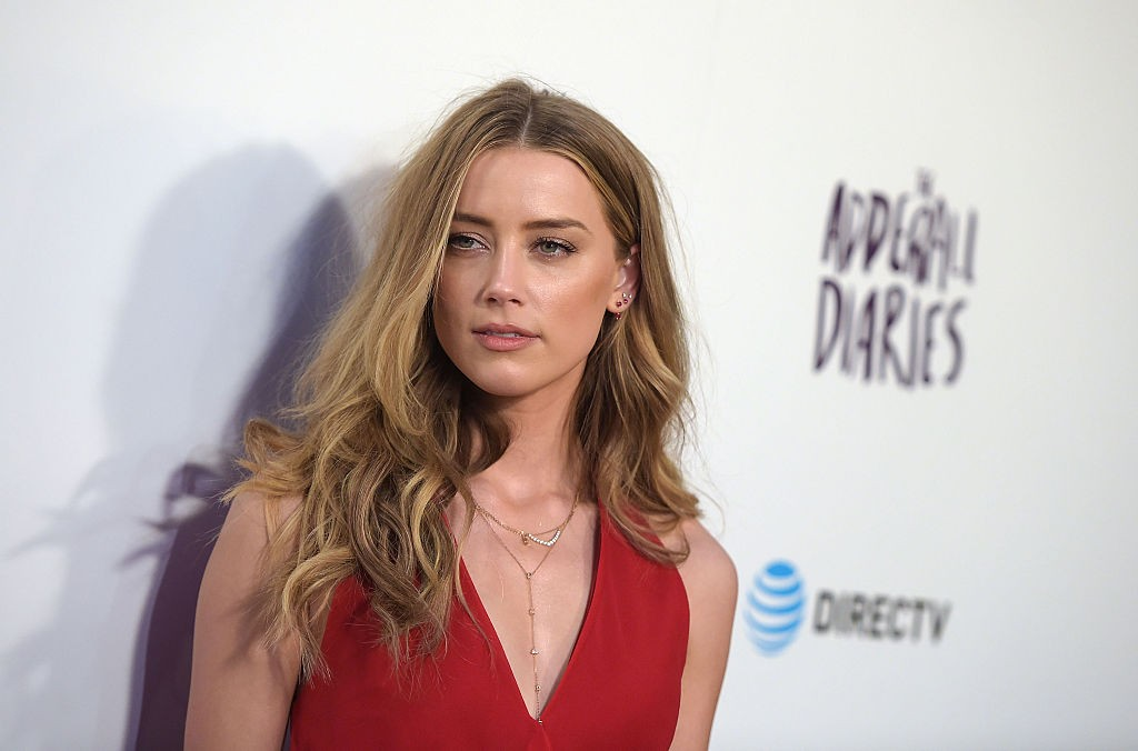 """HOLLYWOOD, CALIFORNIA - APRIL 12:  Actress Amber Heard attends A24/DIRECTV's """"The Adderall Diaires"""" Premiere at ArcLight Hollywood on April 12, 2016 in Hollywood, California.  (Photo by Jason Kempin/Getty Images)"""