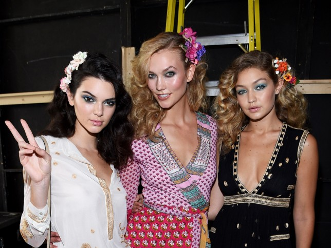 NEW YORK, NY - SEPTEMBER 13:  (L-R) Models Kendall Jenner, Karlie Kloss, and Gigi Hadid pose backstage at the Diane Von Furstenberg Spring 2016 fashion show during New York Fashion Week at Spring Studios on September 13, 2015 in New York City.  (Photo by Dimitrios Kambouris/Getty Images)