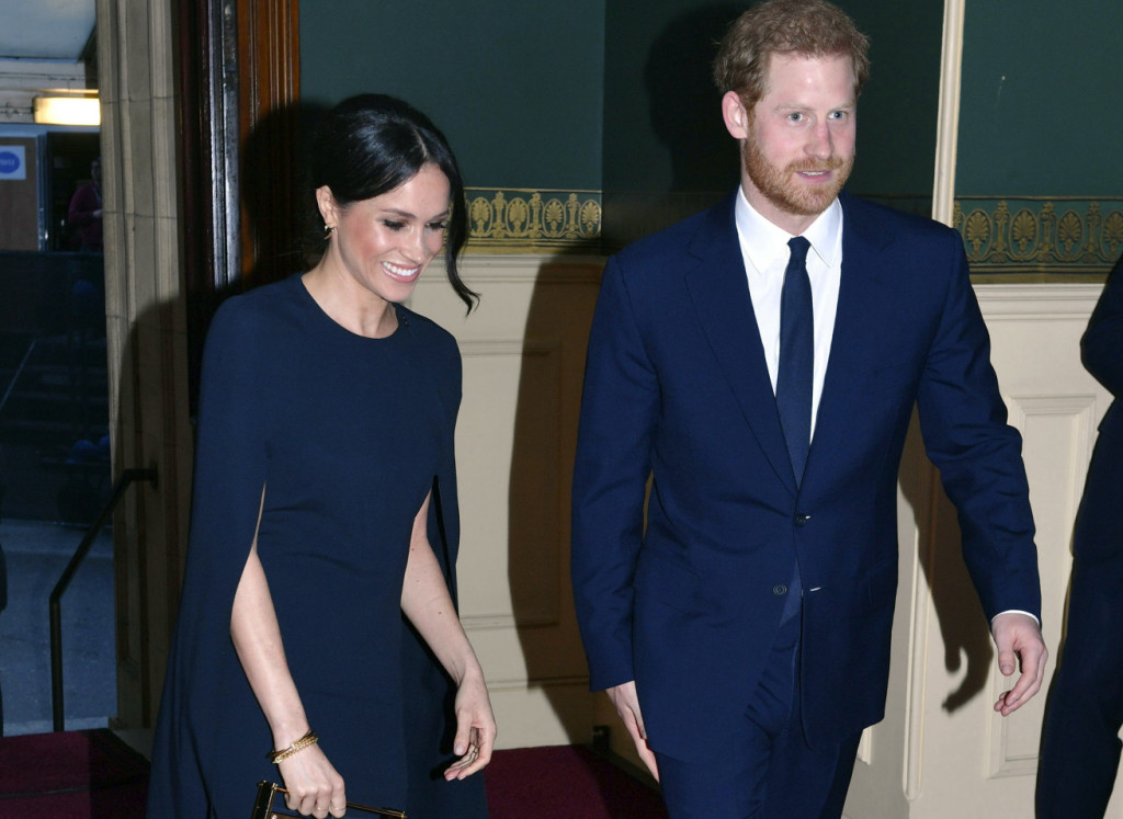 Britain's Prince Harry aH MeghaHMarkle arrive at the Royal Albert Hall in London to attend a concert to celebrate her 92nd birthday, Saturday April 21, 2018. (John Stillwell/Pool via AP)