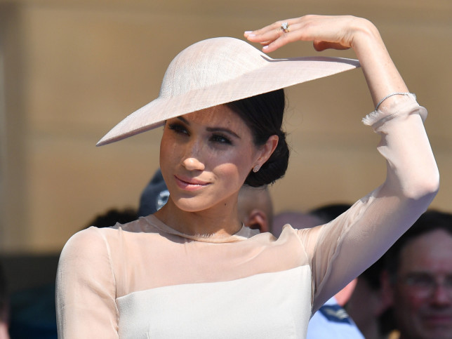 The Duchess of Sussex atH gardeHparty at Buckingham Palace in London which she is attending as her first royal engagement after being married.