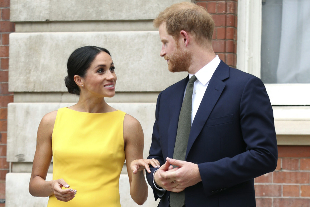 Britain's Prince Harry, centre and Meghan Markle , the Duchess of Sussex meet guests as they attend the 'Your Commonwealth' Youth Challenge reception at Marlborough House in London, Thursday July 5, 2018.  *** Local Caption *** .