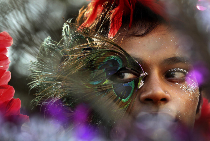 A participant wears a mask during a  gay, lesbian, bisexual and transgender parade in Mumbai, India, Saturday, Jan. 28, 2012. Hundreds of people gathered for the march. (AP Photo/Rajanish Kakade)