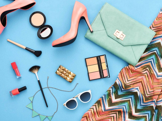 Fashion stylish clothes, cosmetics, makeup accessories. Urban summer girl colorful outfit. Stylish glamor heels, handbag clutch, trendy pants, necklace sunglasses. Woman essentials. Unusual, top view