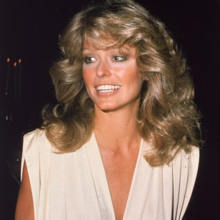American actress Farrah Fawcett arrives at the Golden Globe Awards Ceremony at the Beverly Hilton Hotel, Beverly Hills, California, January 1977. (Photo by Frank Edwards/Fotos International/Getty Images)
